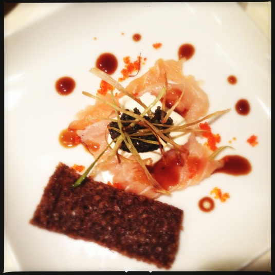 """Caspian Still Life"" — caviar, vodka-cured ivory salmon, lemon truffle creme fraiche, fried scallions, flying fish eggs, black licorice reduction & pumpernickel"