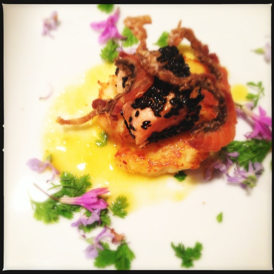 """Fin & Skin"" — black sesame-crusted Norwegian salmon, crispy salmon skin, celery root pancake, Satsuma butter, winter blossoms"