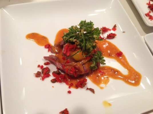 "Kobe flatiron tartare ""blossoms,"" quail egg, curried ketchup emulsion, caper & pickled ginger mirepoix and fried parsley"