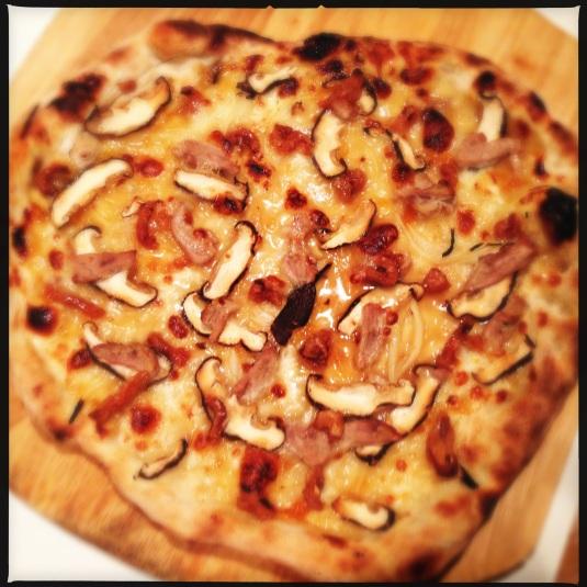 Duck cracklings, confit and plum sauce pizza