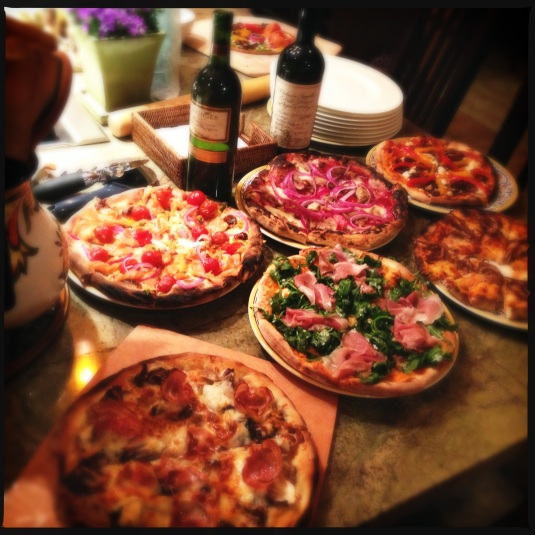 Pizzas (clockwise from top left): smoked salmon and cream cheese; duck with Chinese plum sauce and red onions; roasted peppers and feta; spicy calamari; arugula and proscuitto di Parma; and wild mushroom with radicchio and pancetta.