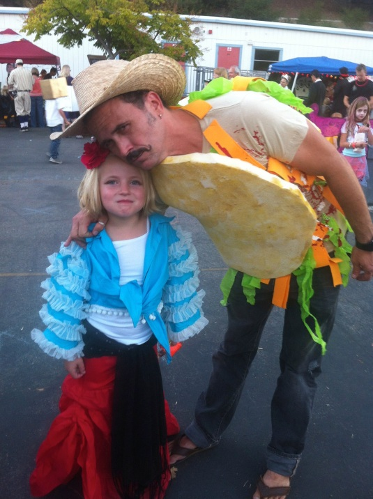 The author in taco costume with friend Lucy at the Halloween carnival, 2012