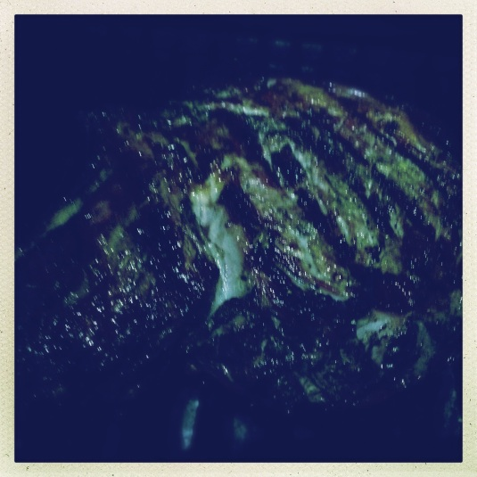 Juicy ribeye on darkened grill