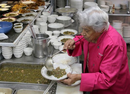 Leah Chase serving up bowls of gumbo z'herbes in her New Orleans restaurant, Dooky Chase