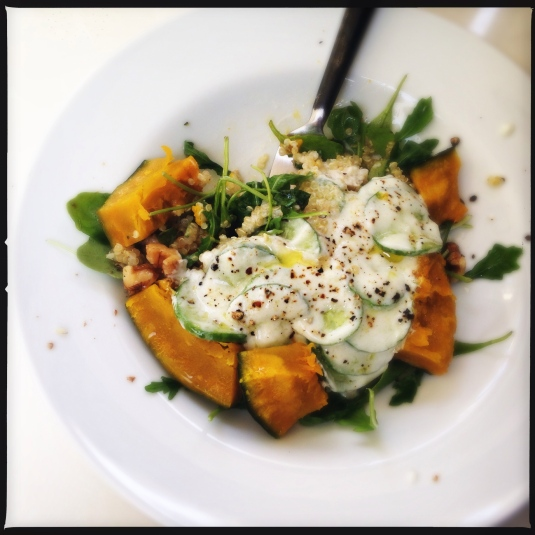 Arugula & quinoa salad with roasted pumpkin, walnuts and yogurt cucumbers