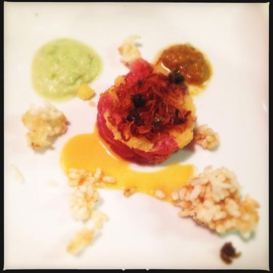 Hawaiian ahi tuna tartare, house-cured capelin caviar, crisp rice, fried shallots and capers, three sauces