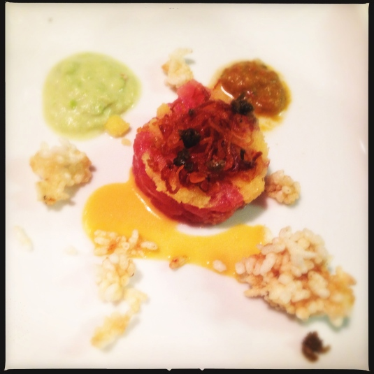 Hawaiian ahi tuna tartare, house-cured capelin caviar, crisp rice, fried shallots and capers, three sauces