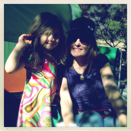 Happy, lightly dressed girls, camping in January