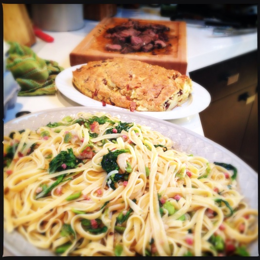 Fettuccine with fava beans, savory Pascal bread, garlic & rosemary leg of lamb