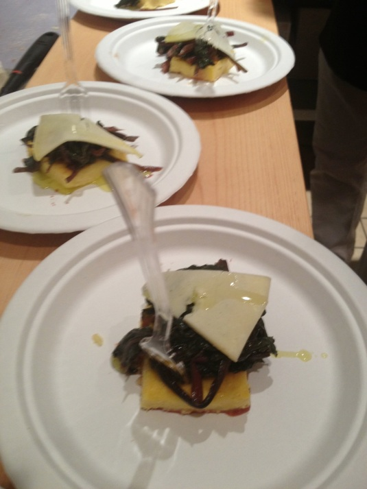 Polenta squares with braised beet greens and asiago cheese