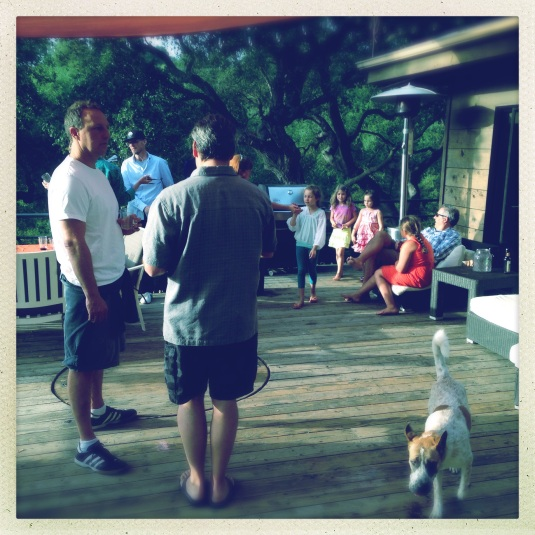 Guests and their mint juleps, dogs and kids out on the deck