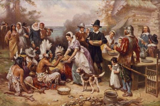 Kind conquerors feeding the savage Indians at the first Thanksgiving