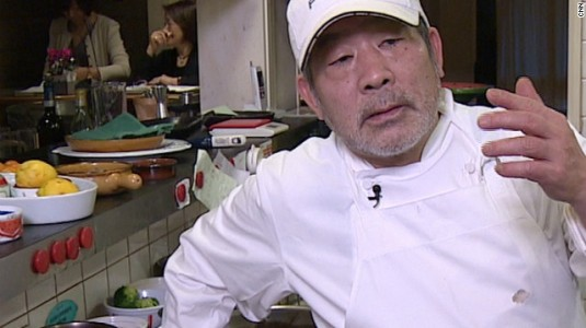 Tokyo chef Toshio Tanabe trying to explain why his dirt tasting menu is a good idea