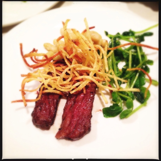 "Course 6: ""Meat II"" — zabuton tiny steak, flageolet beans, matchstick potatoes, spiced pea shoots, wasabi butter"