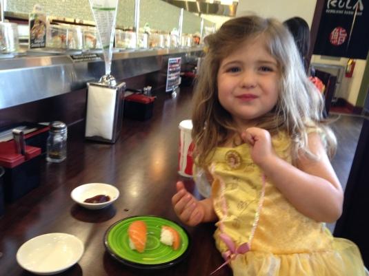 Imogen enjoying her salmon at Kula