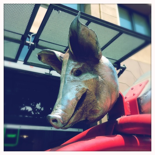 A pig's head outside the market welcomes you — a nod to tradition