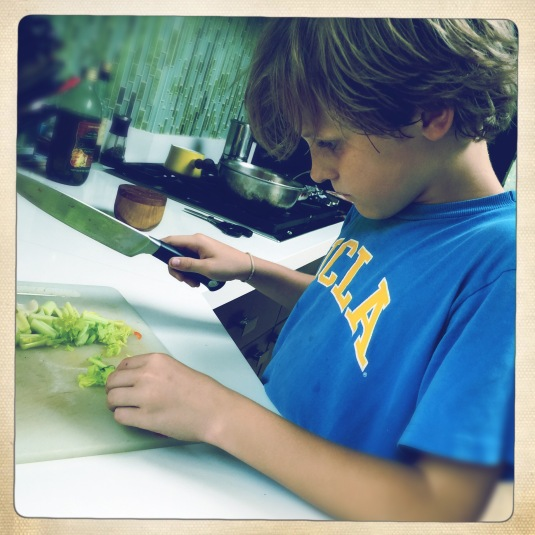 Flynn chopping veggies for the lamb stew