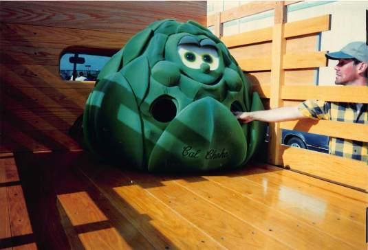Clay puts a move on the Artichoke Festival mascot costume
