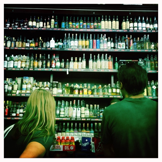 Erin and Alex face off the mezcal wall at the Ramirez warehouse.