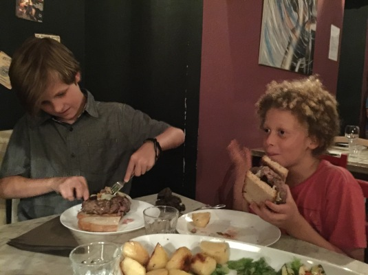 The boys attempt to eat the world's largest hamburgers