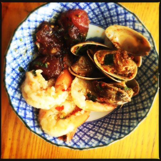 Ahi, garlic shrimp and clam kim chee pokes from Shima's Supermarket