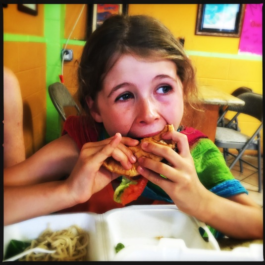 Willa likes her hamburger at Ono Steak and Shrimp