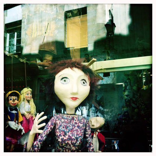 Puppets in a window, the Il St. Louis, Paris